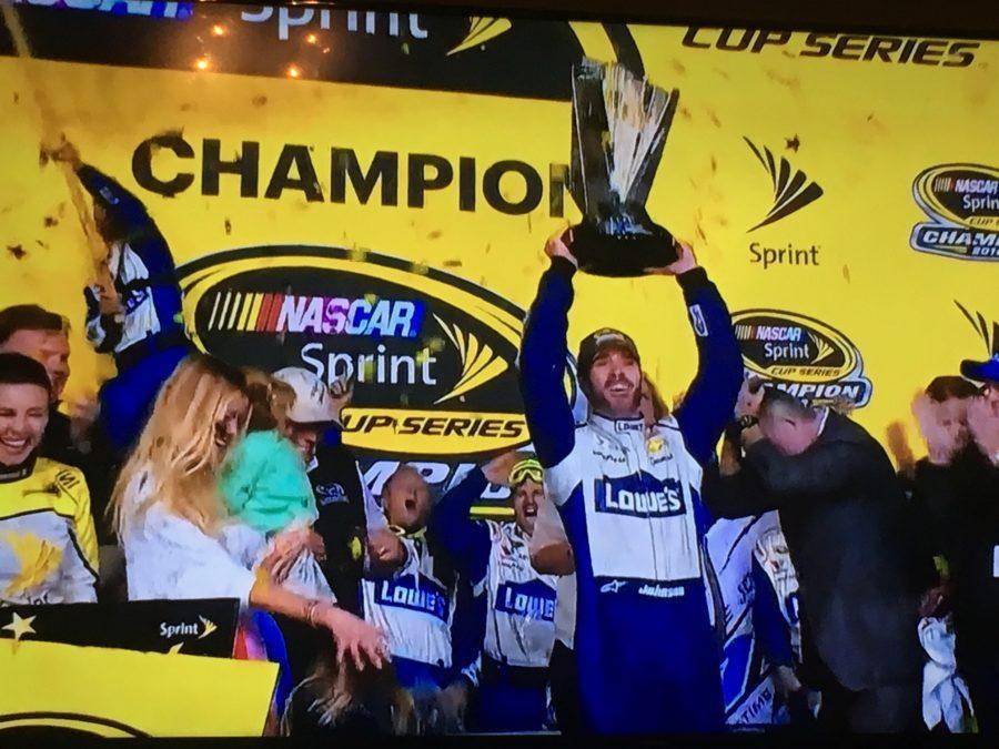 Johnson+hoisting+Championship+trophy