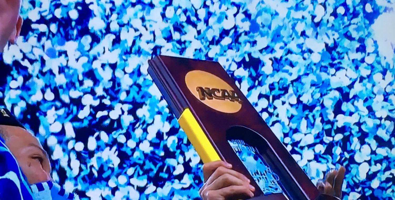 National Championship trophy with Villanova colored confetti raining down.