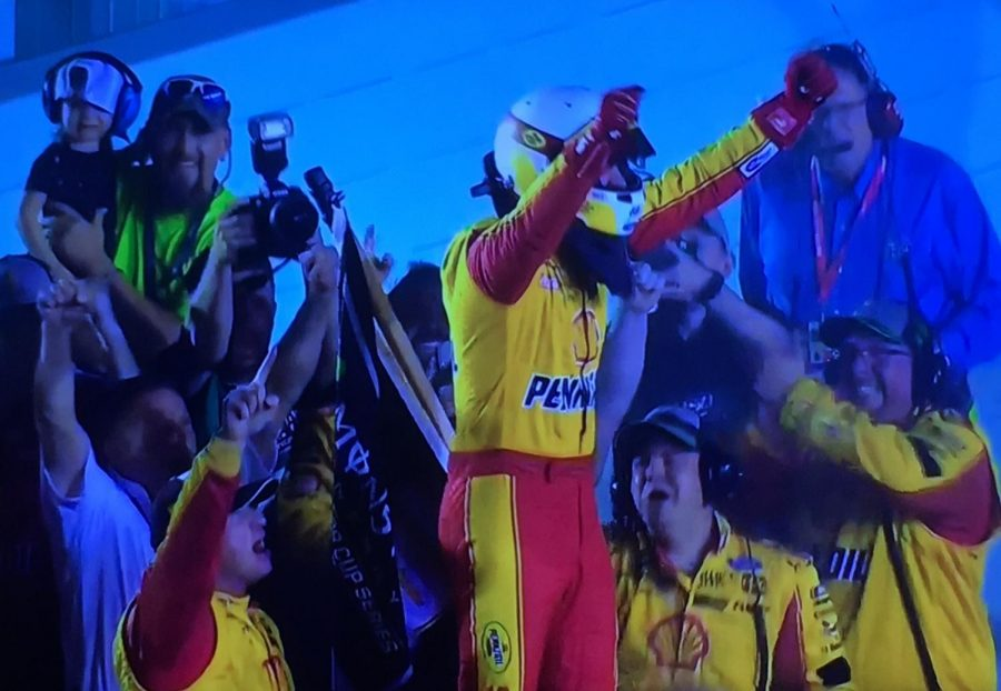 Joey+Logano+celebrates+on+the+frontstretch+after+winning+the+championship%0A
