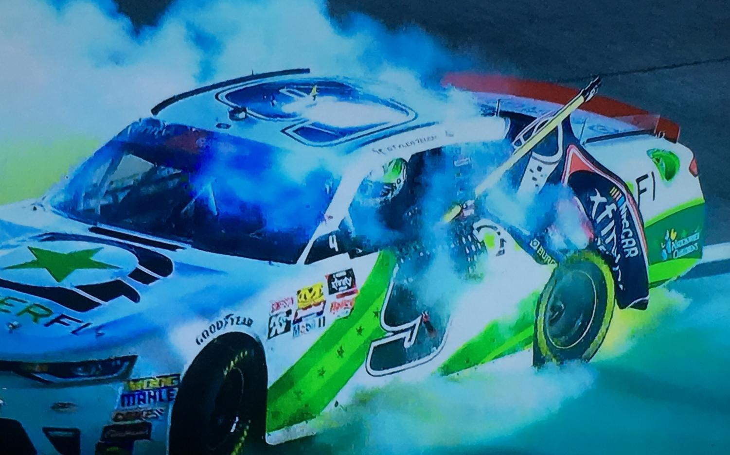 Tyler Reddick burning out with the championship flag after winning the Ford EcoBoost 300