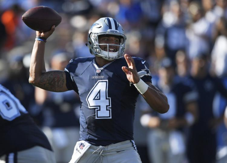 Dak+Prescott%2C+who+had+a+16+yard+rush+on+a+late+third+down+to+help+seal+a+Cowboys+victory%0A