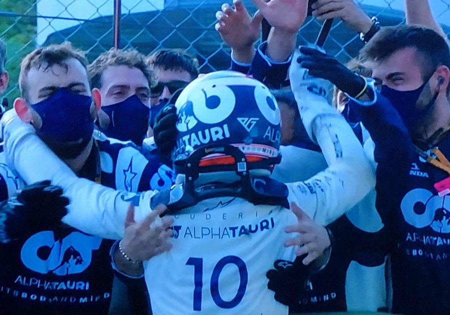 Gasly celebrates with his team after his shocking Italian GP victory