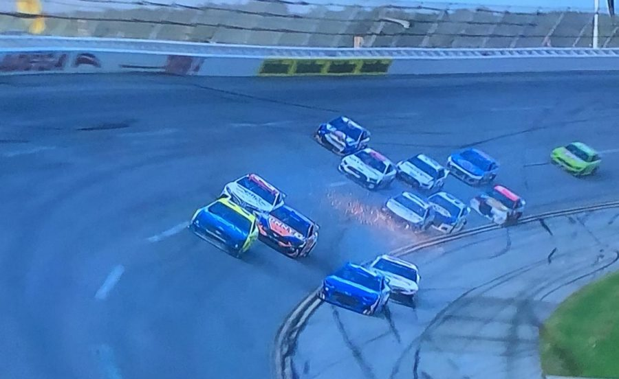 Hamlin(the white FedEx car) dips onto the apron to avoid the 24 of Byron(blue car on the apron)