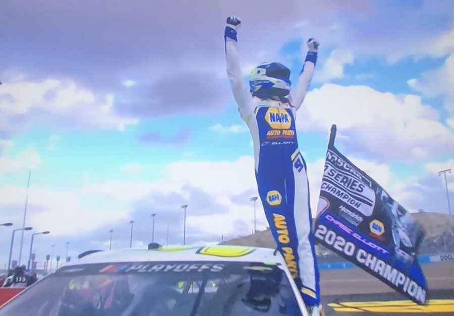 Chase Elliott celebrates after claiming his first championship