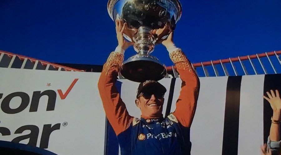 Scott Dixon hoisting the Astor Cup