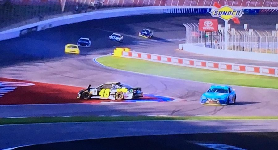 Jimmie Johnson's #48 spins across turn 16 on the final lap, which ended up spinning into the light blue #78 of Martin Truex Jr.