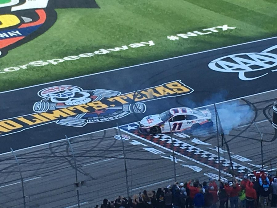 Denny Hamlin does a burnout after claiming his second win of the 2019 season.