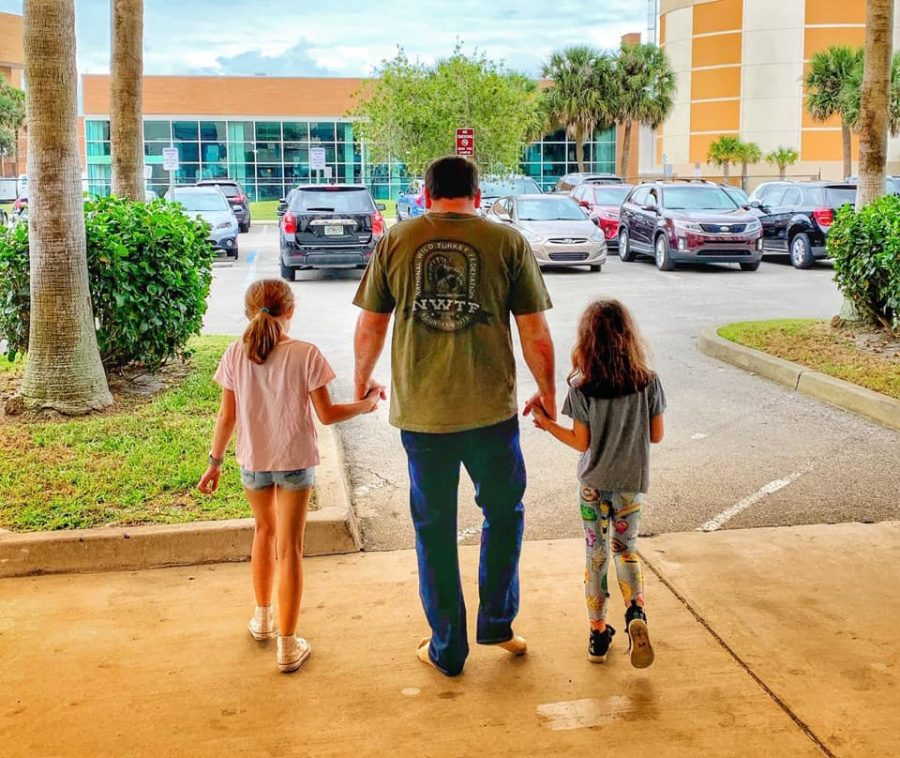 Newman leaves the hospital with his daughers on Wednesday