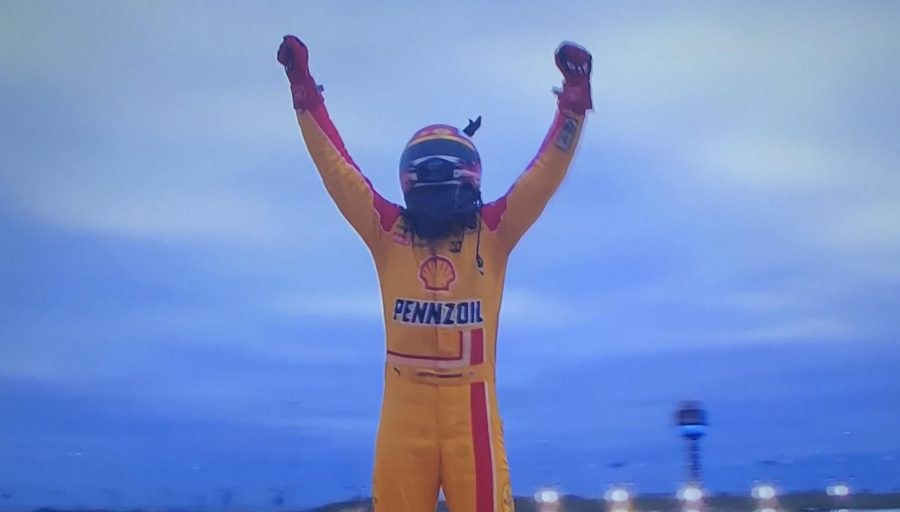 Joey Logano celebrates after winning the Hollywood Casino 400