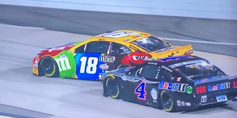 Kevin Harvick hits Kyle Busch's car coming off of the final corner
